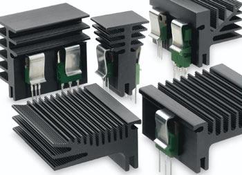 Heatsinks With Lock In Transistor Retaining Springs